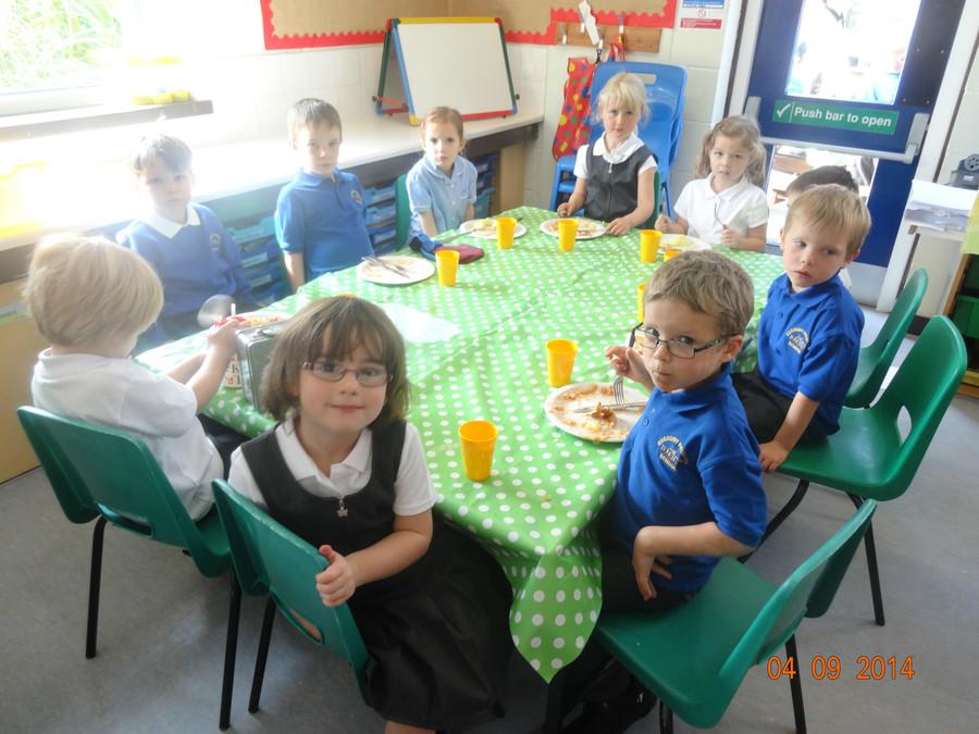 Class 1 children enjoying hot dinners