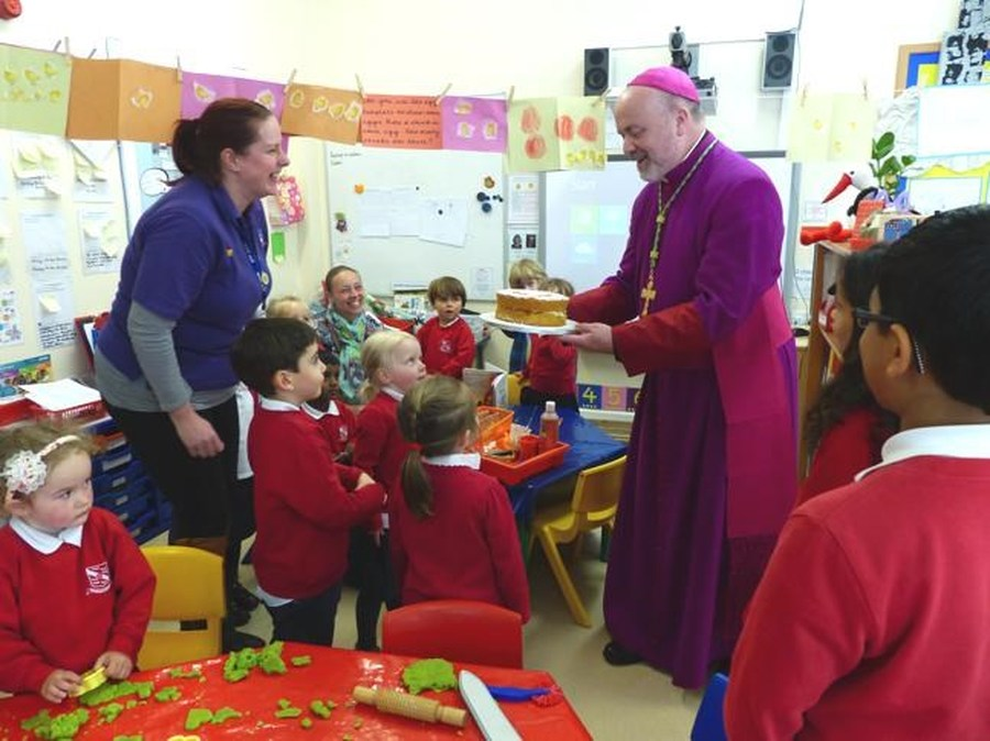 The children present Bishop Marcus with their cake