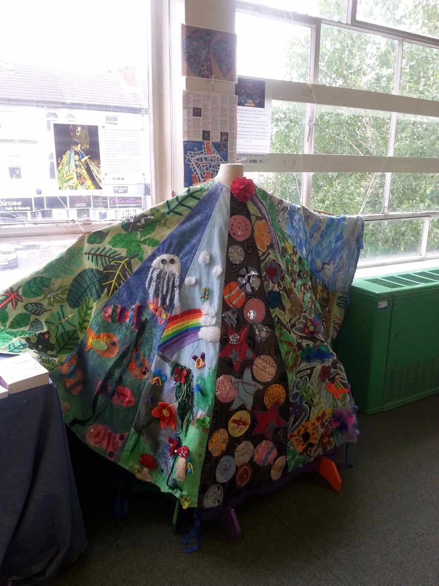 Storyteller cloak on display in Sherwood Library 2015