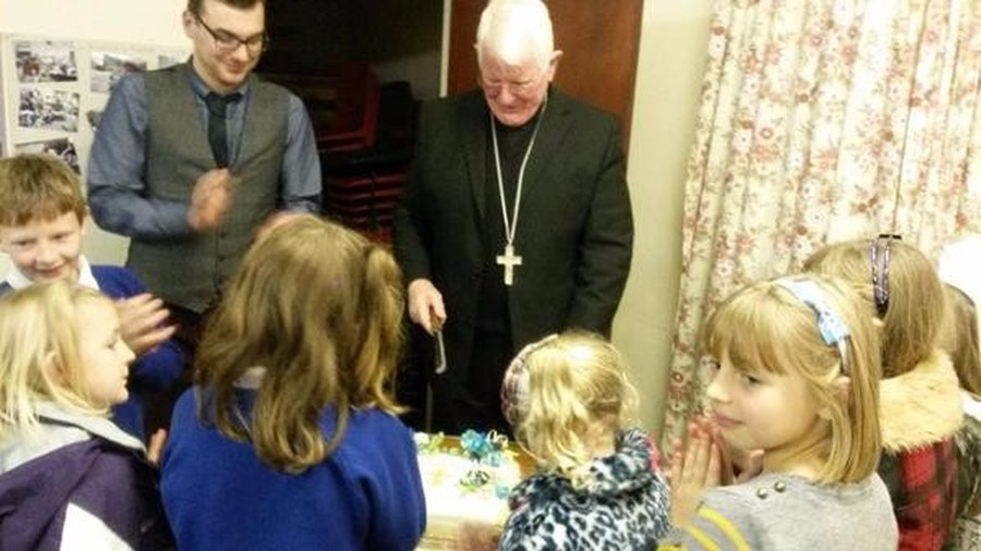 On 21st November 2014, Bishop Michael celebrated a mass to officially amalgamate the parishes of St. Mary of Furness, Ulverston and Our Lady of the Rosary and St. Margaret of Scotland, Dalton in Furness.  As the schools in both parishes are already federated it was a chance for us to celebrate our joining with our sister parish.  The new parish is know as the parish of Sts. Mary and Margaret.  We had a party in the social centre afterwards with a beautiful cake made by one of our talented parishoners.