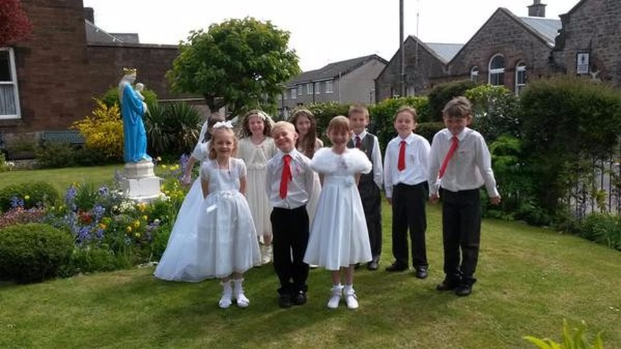 Nine children from Class Three celebrated receiving the sacrament of the Eucharist for the first time on Sunday 14th May.  It was a beautiful day celebrated by the whole parish community.