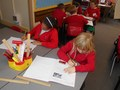 Working neatly in our topic books<br>