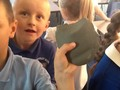 Connor examining artifacts.JPG