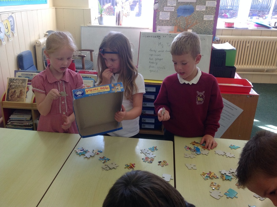 working together to solve the puzzle.