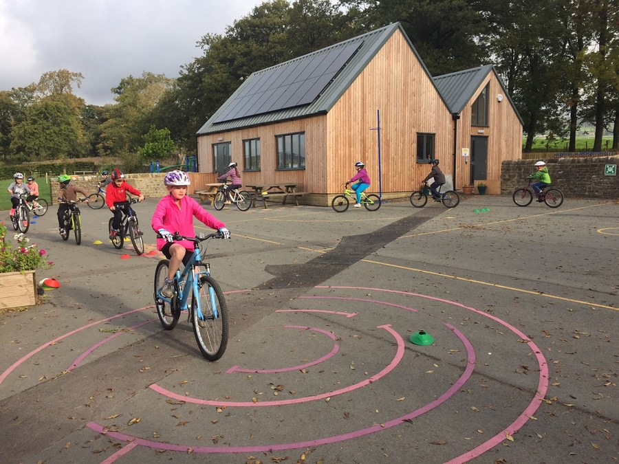 Y5/6 enjoy cycle training with Bikeability in the autumn term.  They build confidence in the playground then head onto the open road in Bolton Abbey.