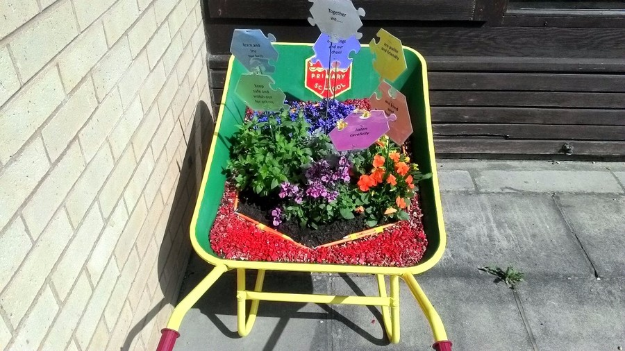 This floral jigsaw art was created by the children and on display in Frost's Garden Centre