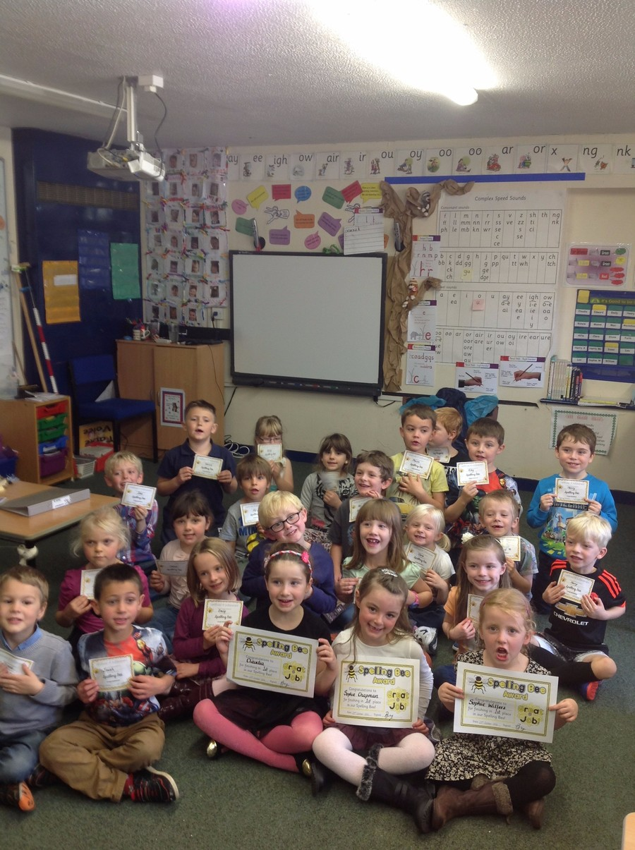 The children proudly showing off their Spelling Bee certificates