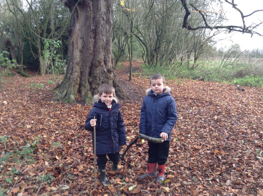 Lucas and Callum finding suitable sticks.