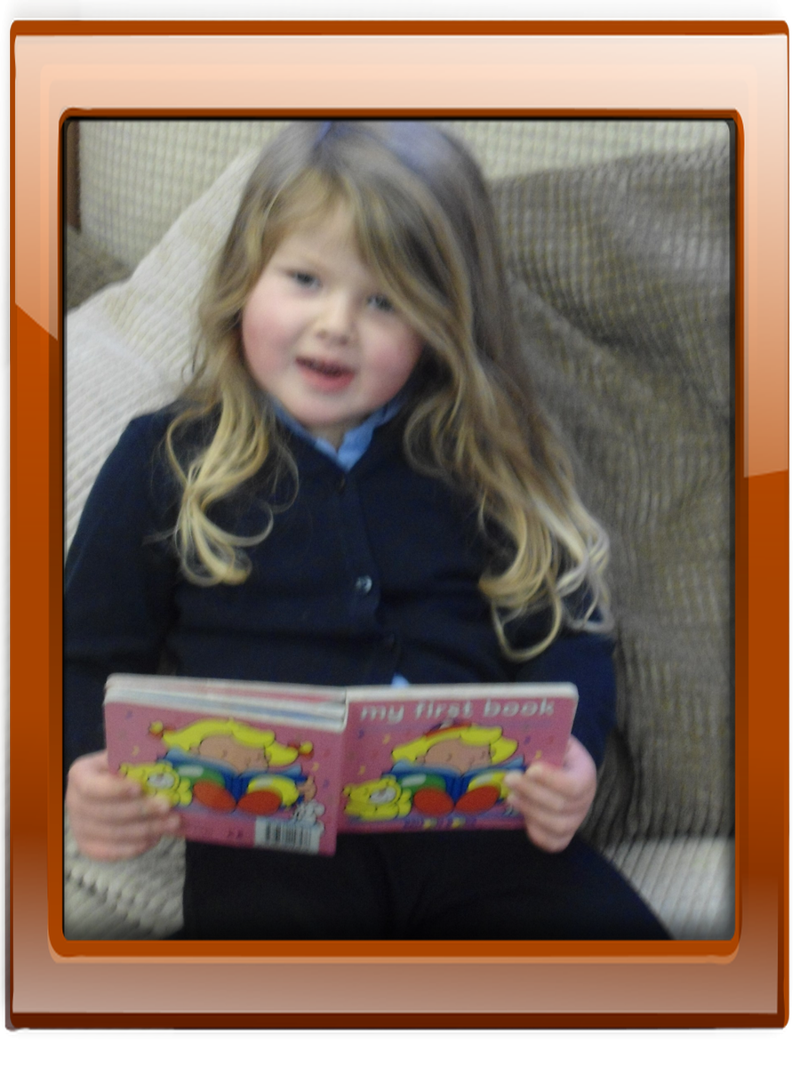 The children have the opportunity to relax in the book corner with a good book from the bookshelf.
