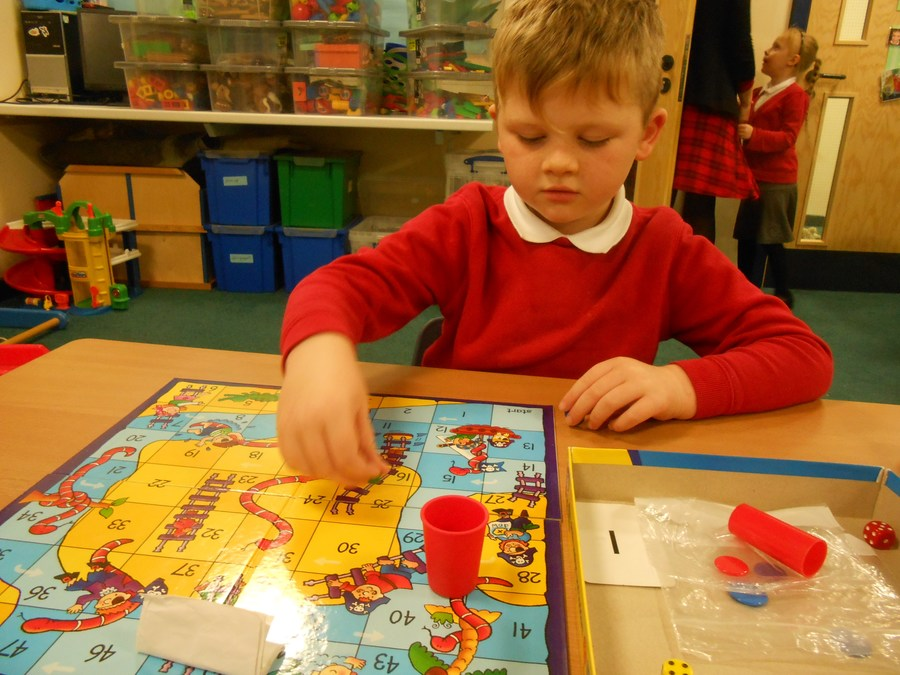 Reegan has been enjoying playing games and learning to take turns.