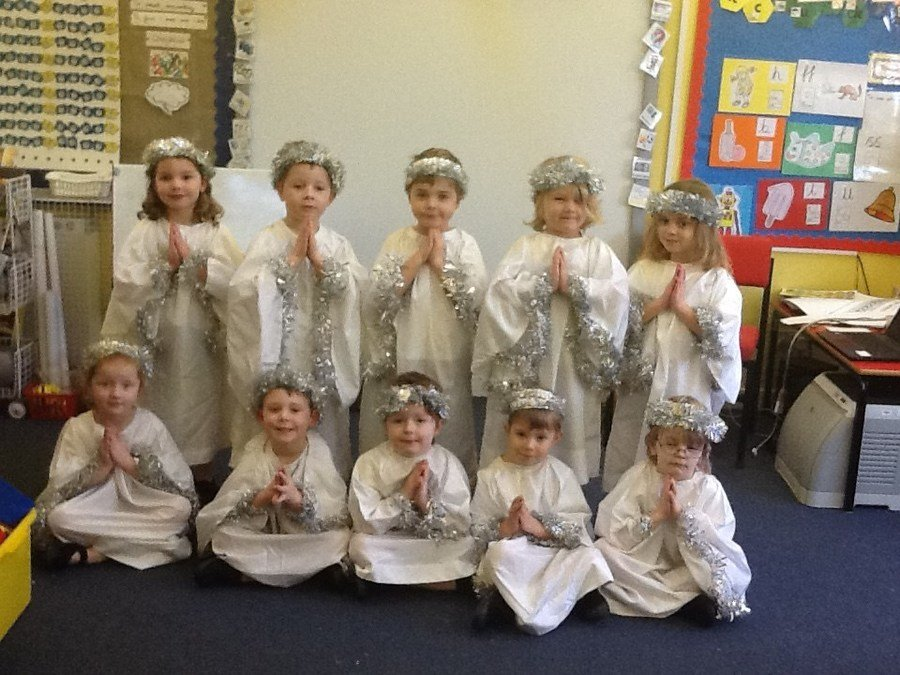 Reception class as Angels in their Christmas Nativity