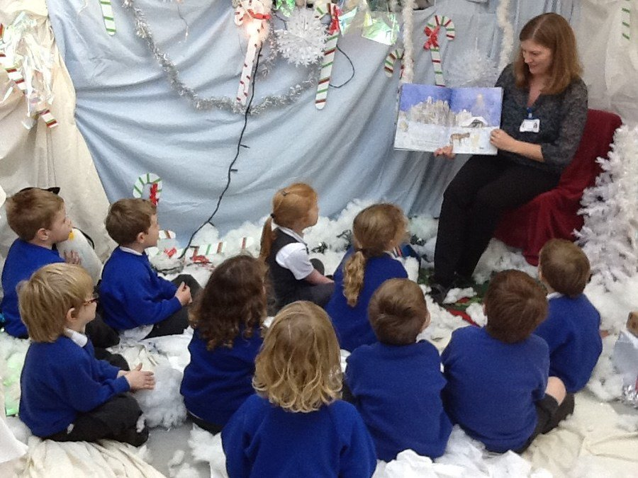 Reception class enjoying a story in the grotto