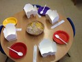 The children tried to use chopsticks to pick up 'noodles'