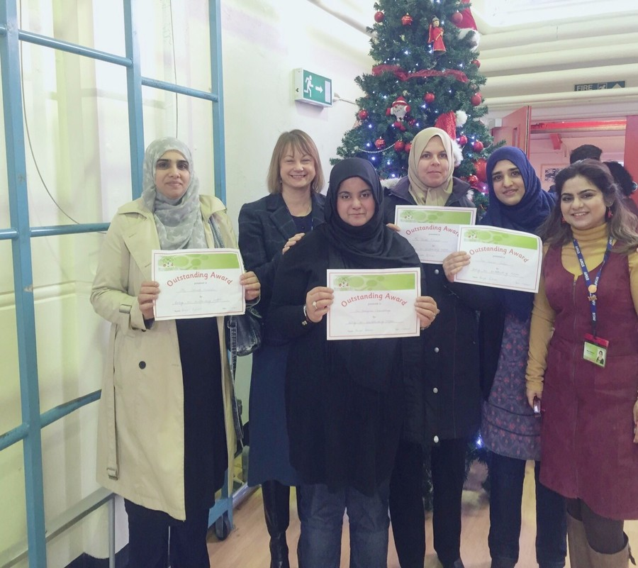 Parents receiving certificates for all their help an continued support.