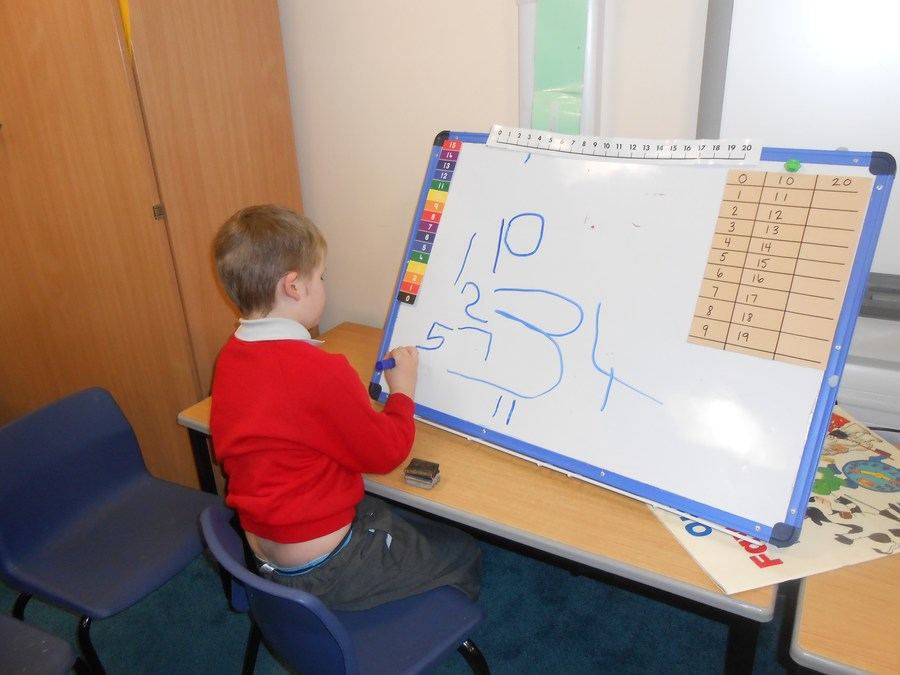 Reegan is making great progress with writing his numbers.