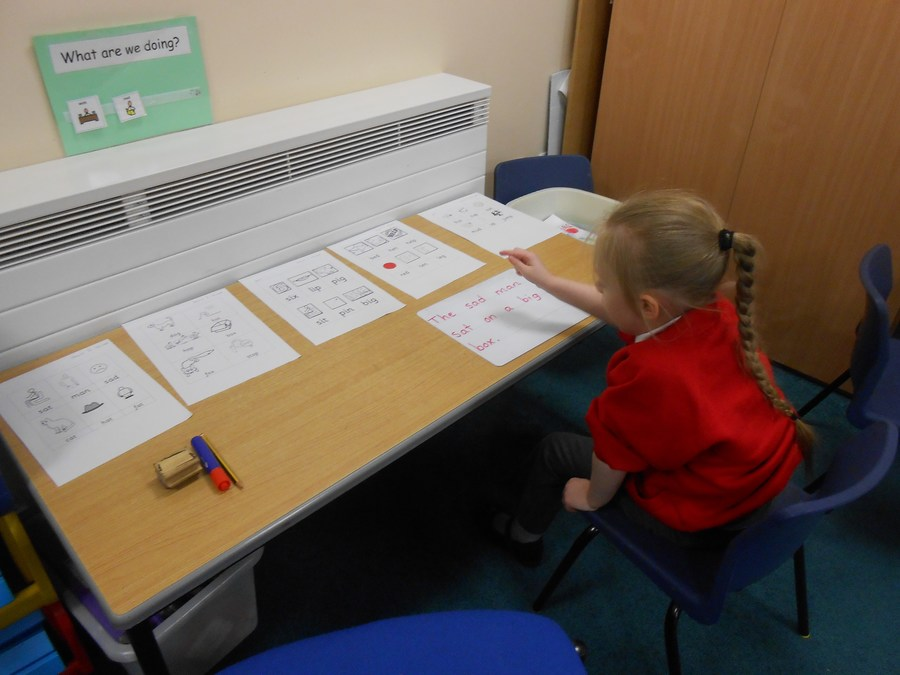 Olivia is learning how to read sentences with familiar words. This is a crucial step in developing symbollic understanding.