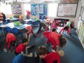 Click the picture to see Class 5 stretching to warm up!