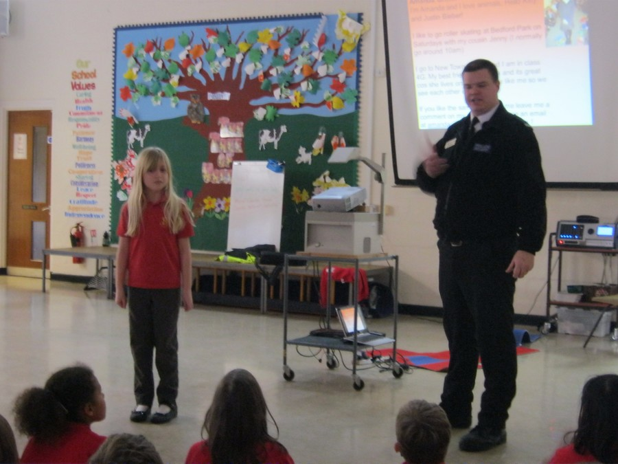 Local Police Officers leading an E-Safety assembly for our pupils