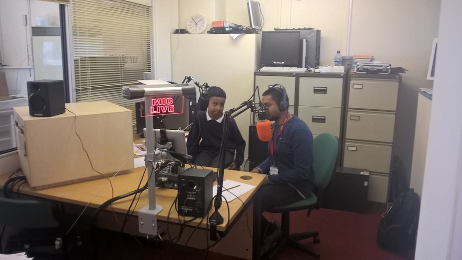 Mr Miah and his son Amaan in the Radio Studio