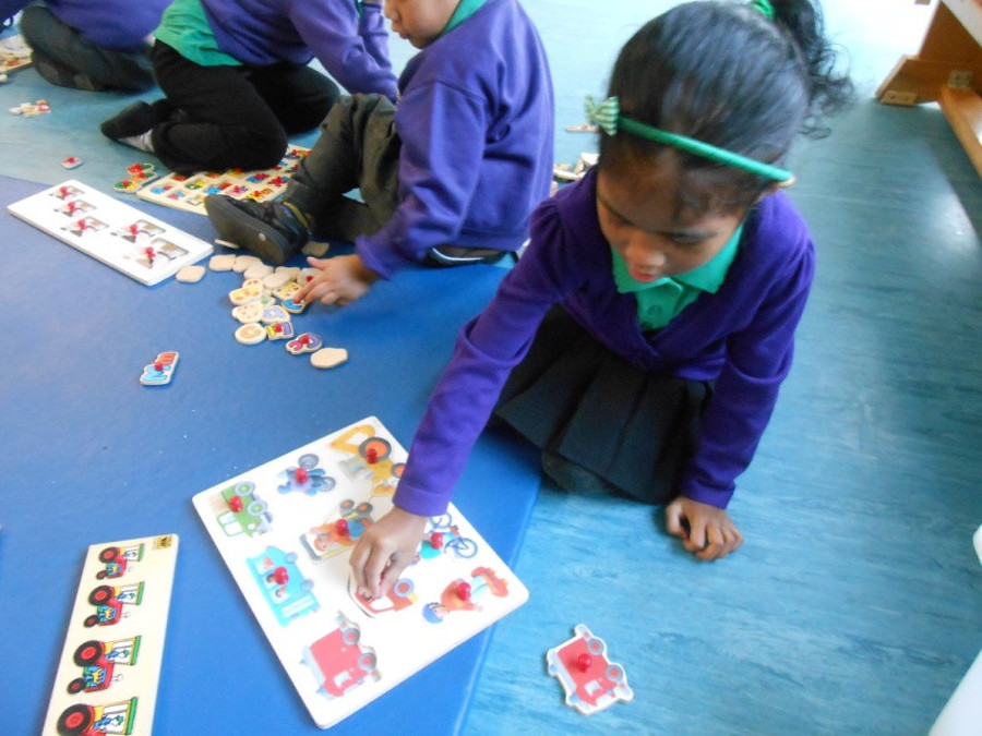 Completing jigsaws linked to transport. Our theme was Journeys.