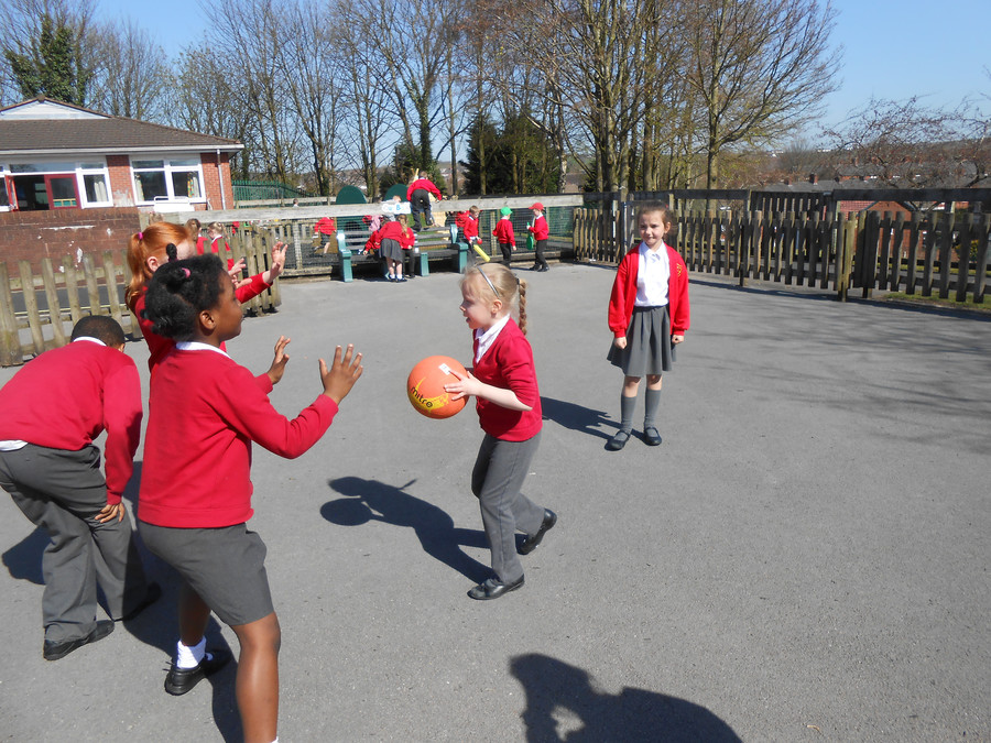 Olivia and some girls in Year 2 have a great time playing catch on the yard at playtime.