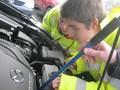 Liam and Georgia looking at starter motor.JPG