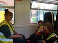 Mums have fun on the train to Forest School!.png