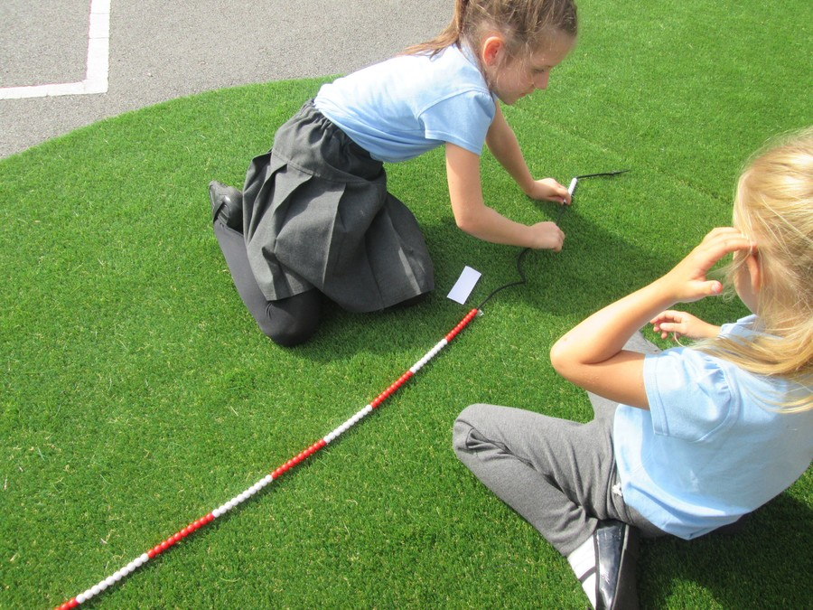 We are using the bead strings to understand place value