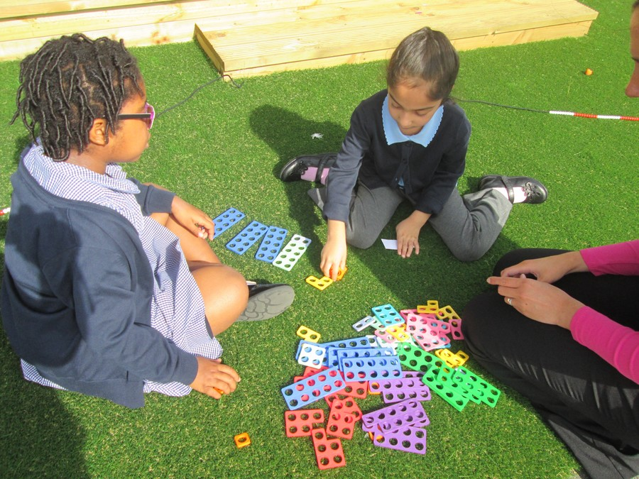 We are making number sentences with the Numicon. It was more tricky because we couldn't use the 10 piece to make our number totals.