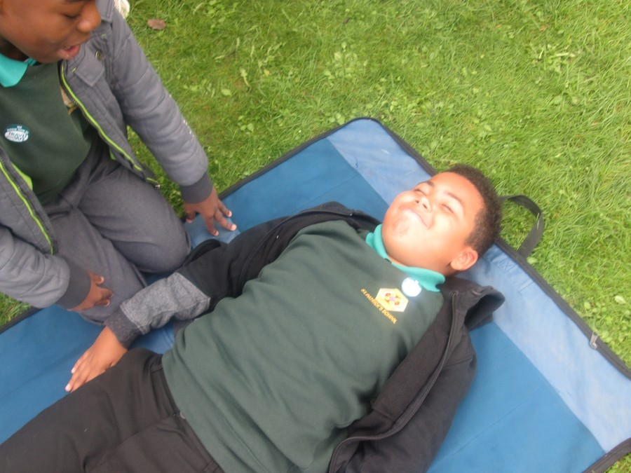 Recovery position lesson from St Johns Ambulance.