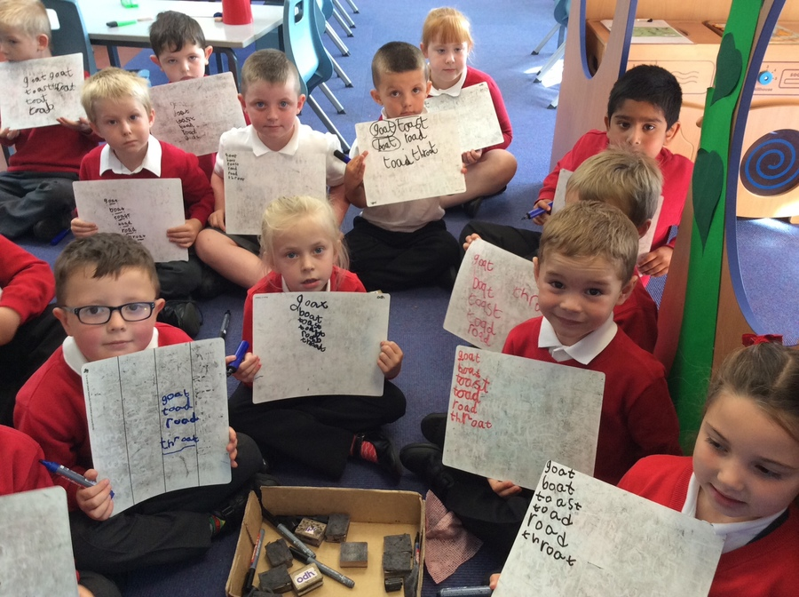 Practising our spelling. We use Read Write Inc phonics to learn how to read and spell words.