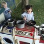 Cooking in the mud kitchen.JPG