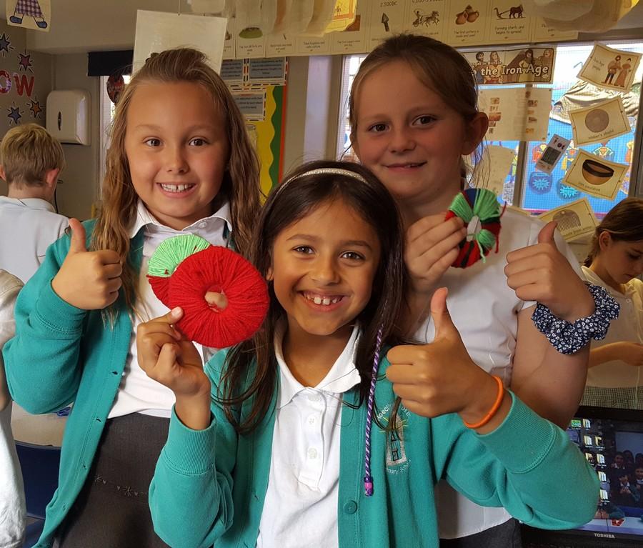 We have been making apple pom poms for our Harvest Festival!