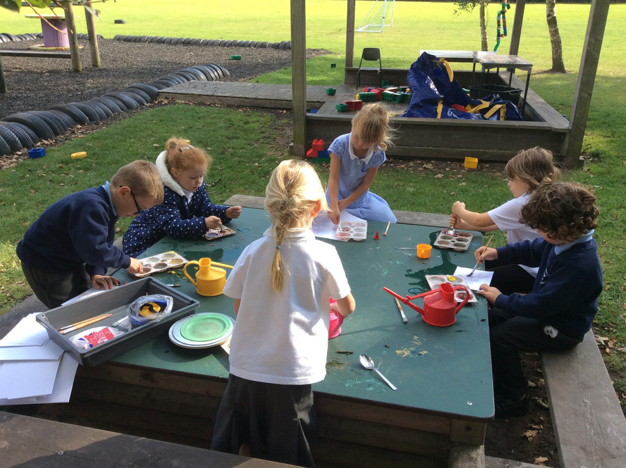We collected berries and flowers to make our own paint! Squishing them up was great fun.