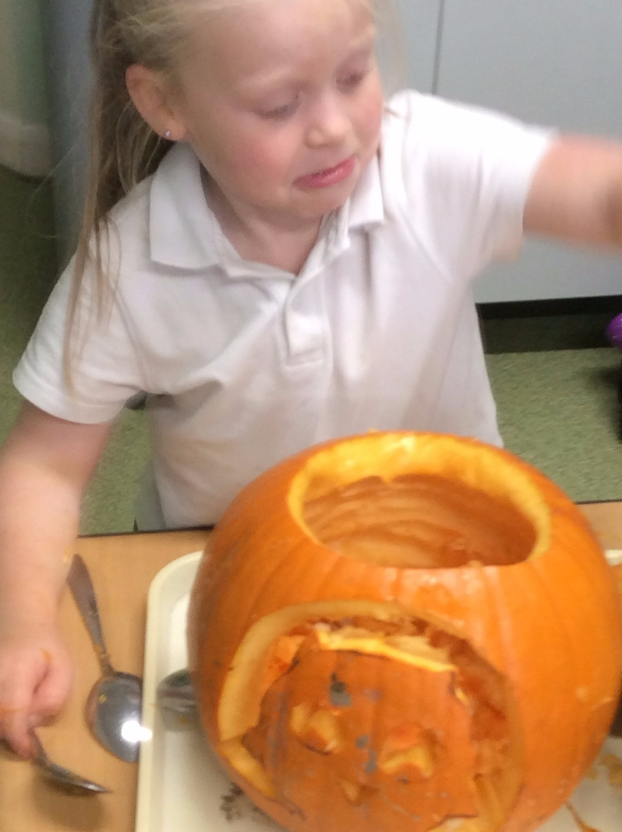 Carving Owl Babies in our pumpkin