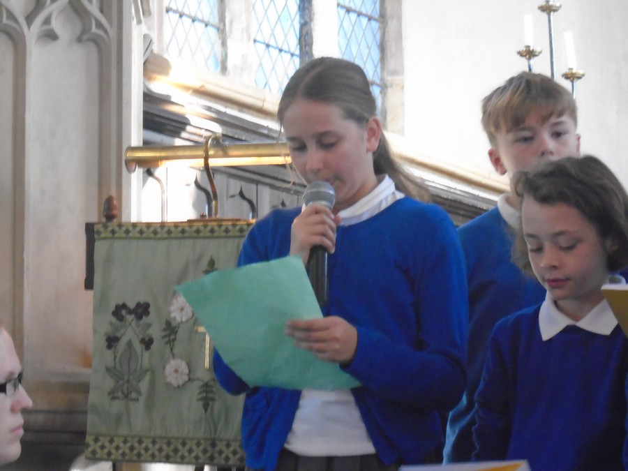 Lily from Neptune class reading her poem