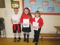 Brogan, Erin and Anya received certificates from the library service after they took part in the Summer Reading Challenge.