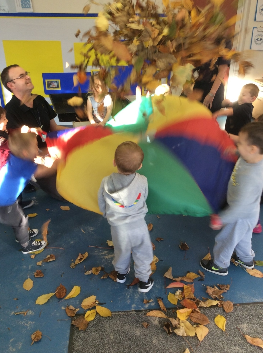 Playing parachute encourages the children to work together and follow instructions to reach a common goal