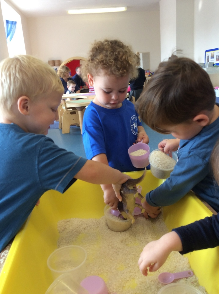 Pouring into and emptying different size containers allow the children to begin to understand volume.