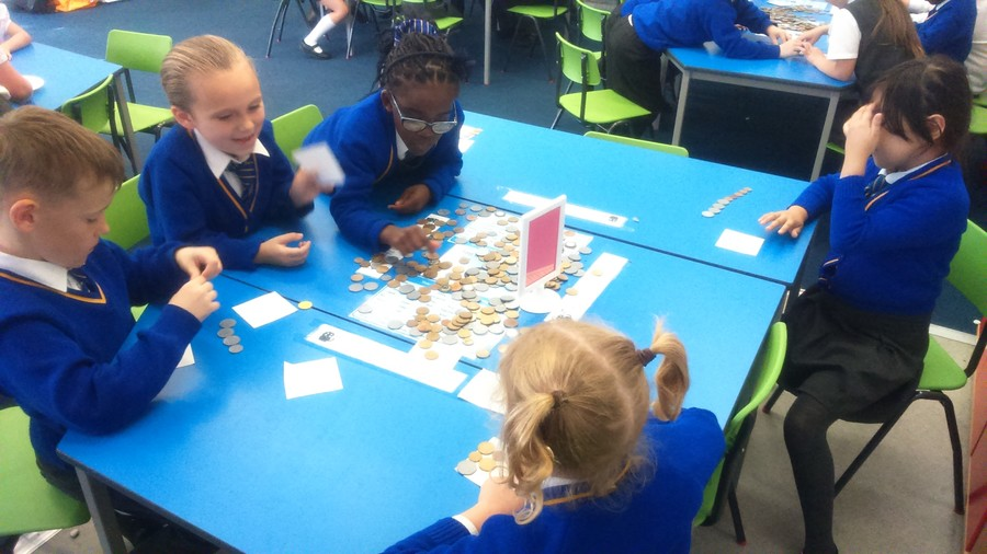 Children choosing coins to make a given total