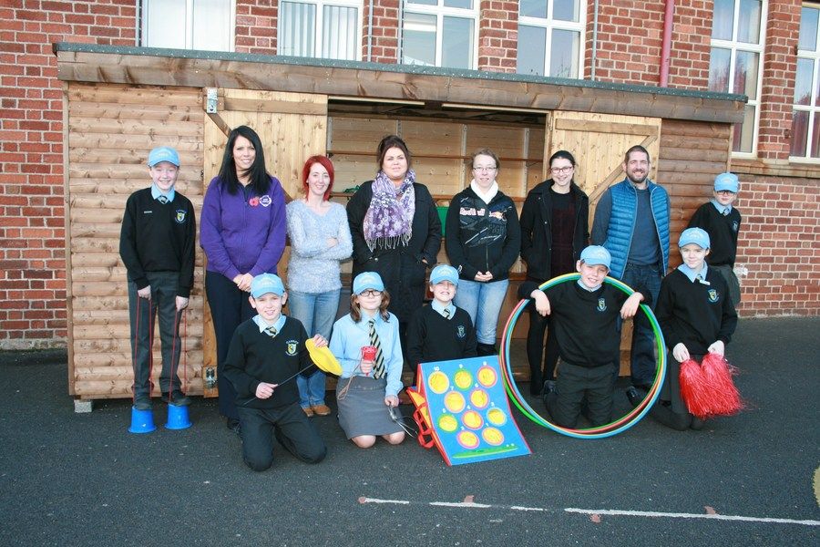 Some members of the Friends of Carrick Committee with some Playground Pals beside the shed and equipment they have provided.
