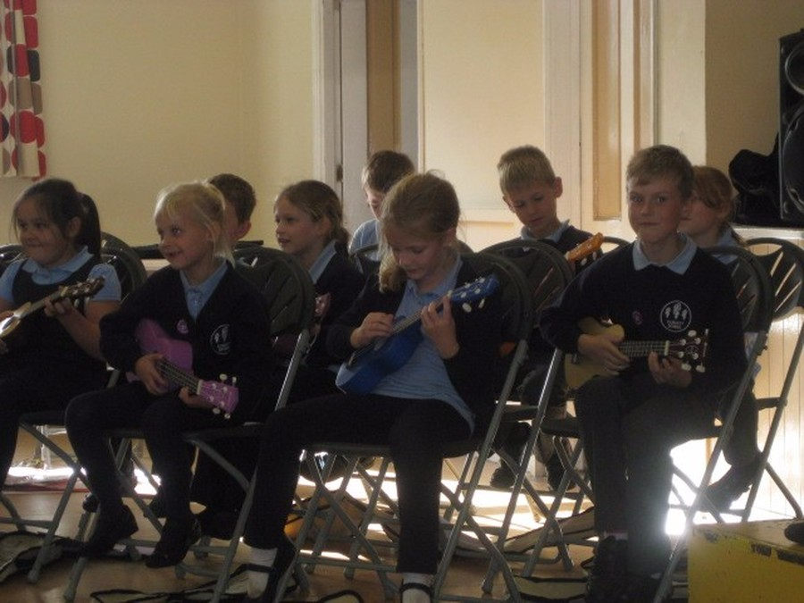 Badgers performing with their ukulele