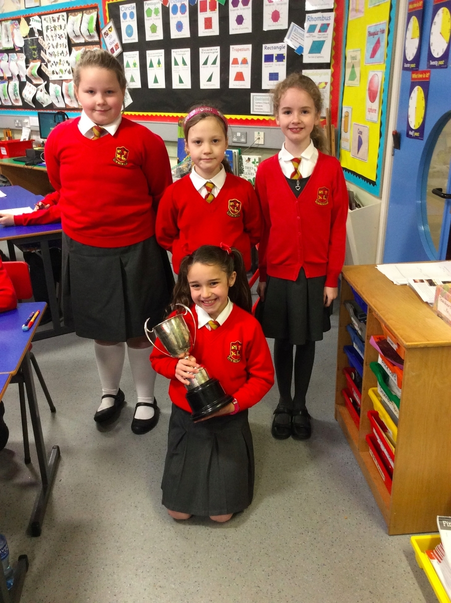 Pupils from P.5R who took part in the recent speech and drama festival. Alex displays her trophy for winning the Autoplas Cup in the Champions of Champions.  Well done girls
