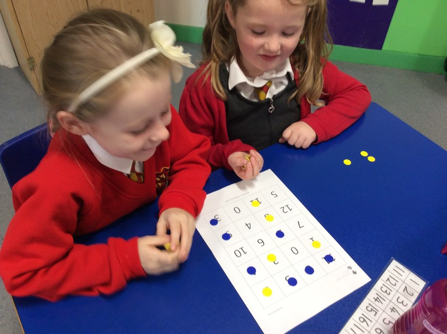 Having fun playing a Maths game together