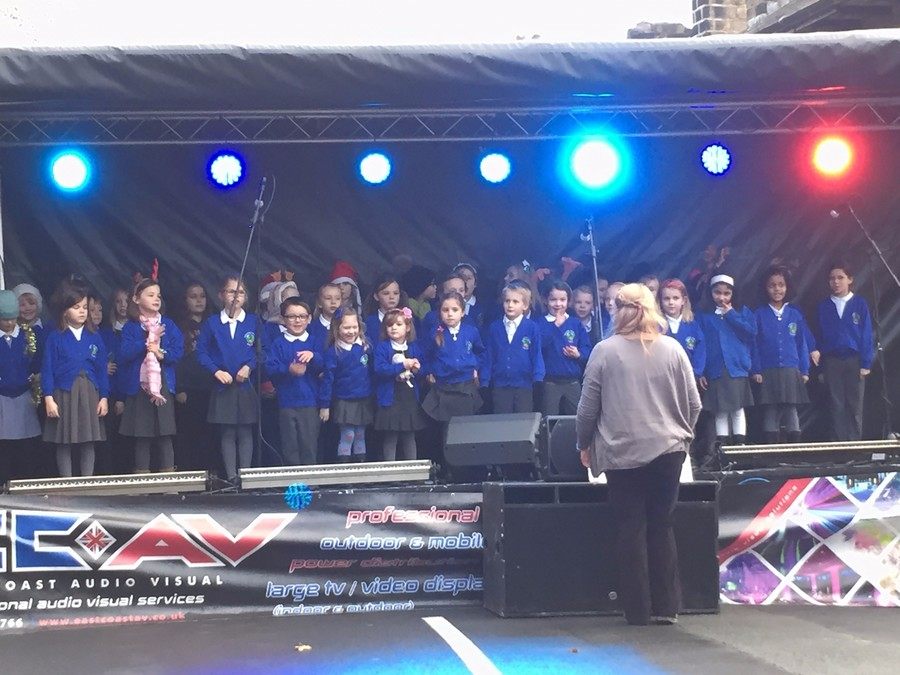 Our choir sing at the Guiseley lights switch on