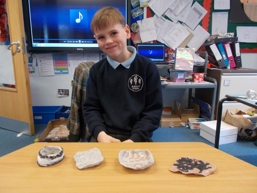 They have produced patterns and painted designs on clay slabs in a Greek style. Also they have made patterns on slabs using terracotta clay and made a coil pot.