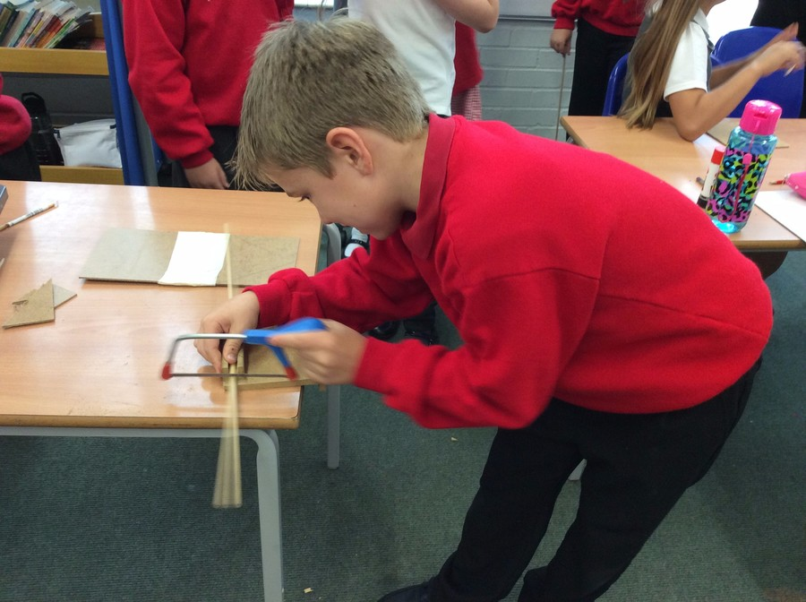 Making wooden boats to go with our class reading book 'Kensuke's Kingdom.'