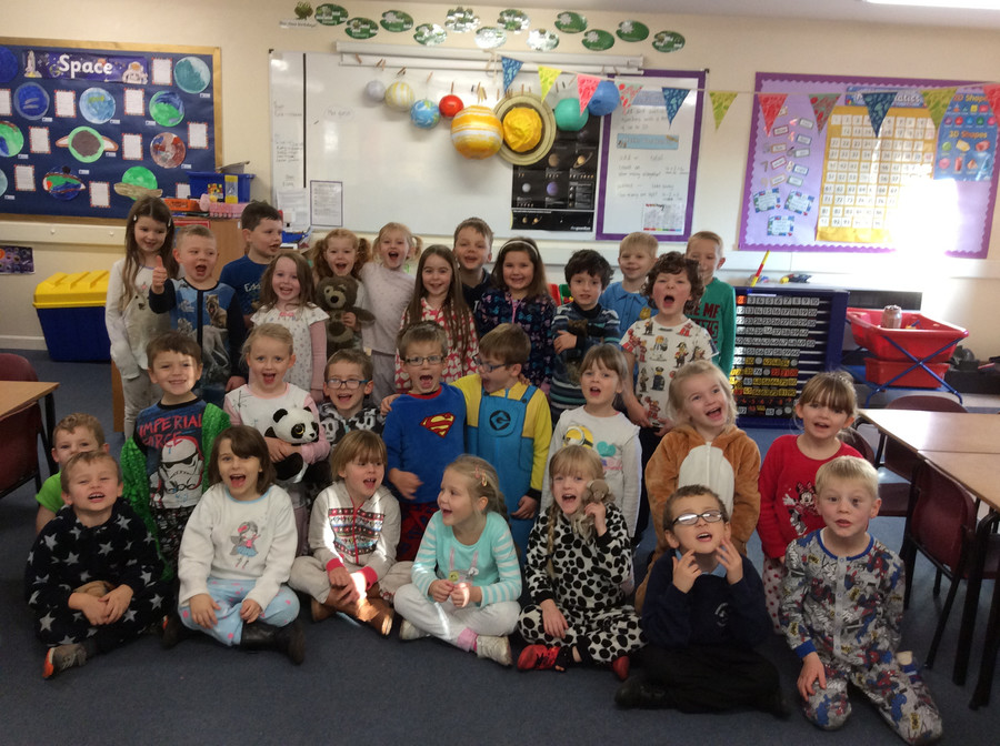 Here we are looking cosy on pyjama day. We listened to lots of bedtime stories at the 'fireside'.