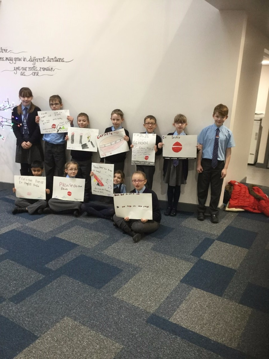 Our School Councillors designed some posters to remind parents & visitors to park safely away from school.