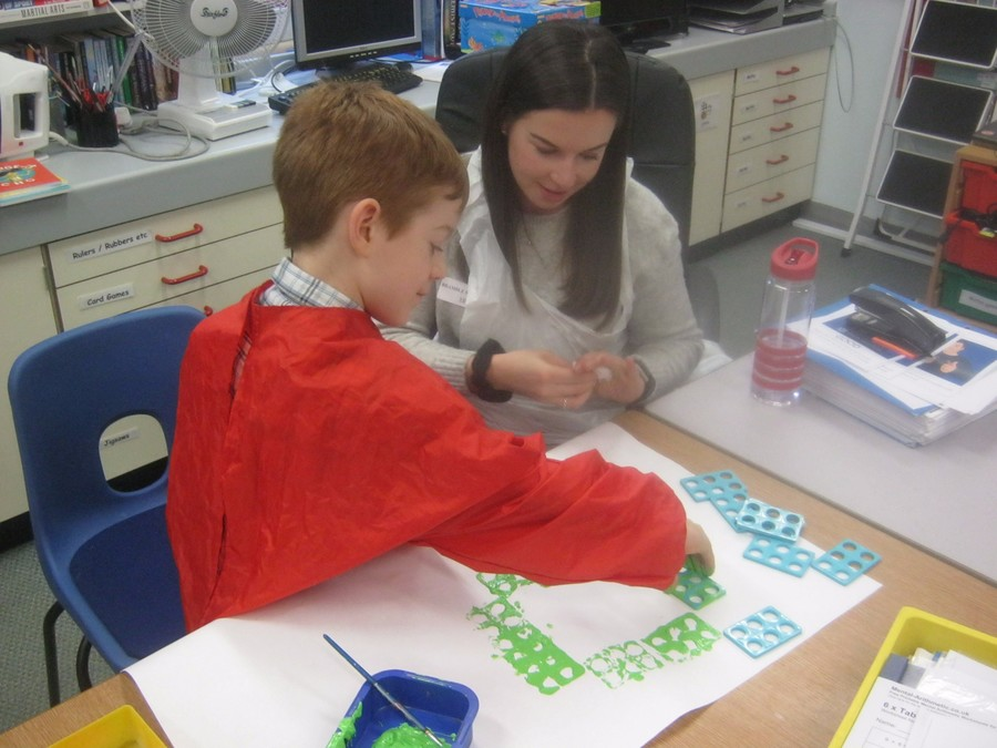 Jennifer helps Felix make a cat with numicon!